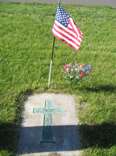 Marker with flag and flowers