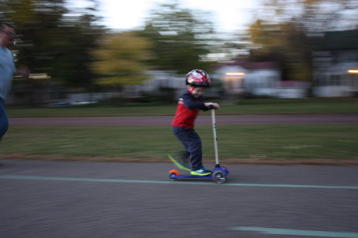 Byron on a Scooter Dad in Pursuit