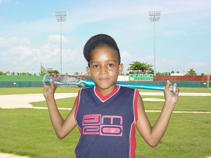 Dominican boy with a baseball bat